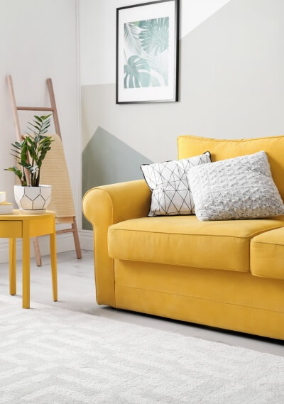 A very bright living room with a yellow upholstered sofa. Upholstery fabric Brawa - marboss.eu